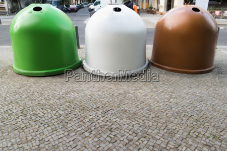 three recycling bins containers