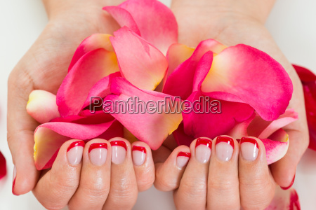 female hands with nail varnish holding