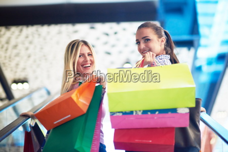 happy young girls in shopping