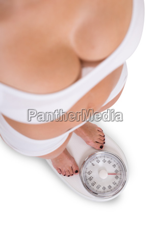 woman checking weight over white background