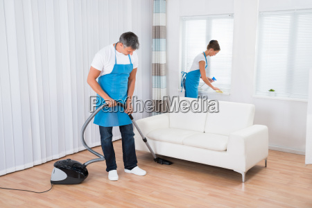 two cleaners cleaning office