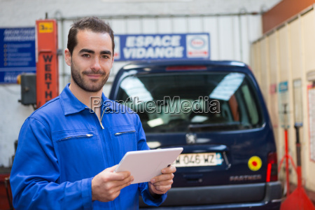 young attractive mechanic working at the