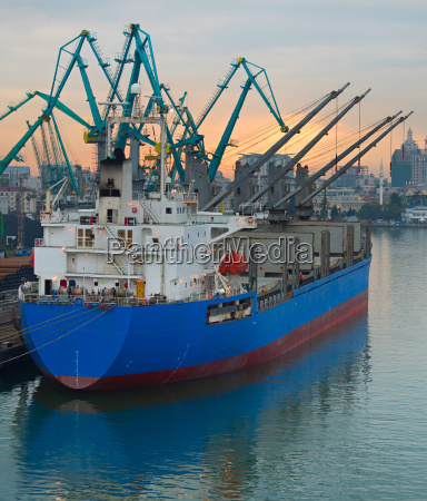 ship with cranes at port