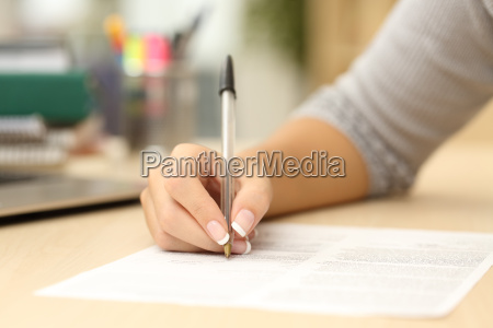 woman hand writing or signing in
