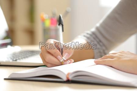 woman hand writing in an agenda