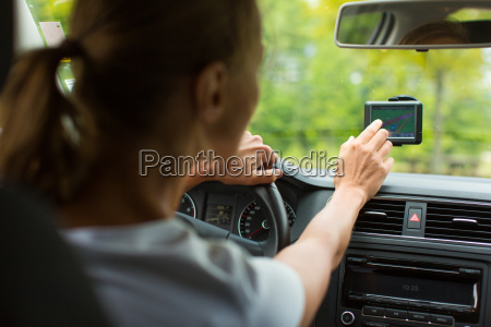 young woman driving her car on