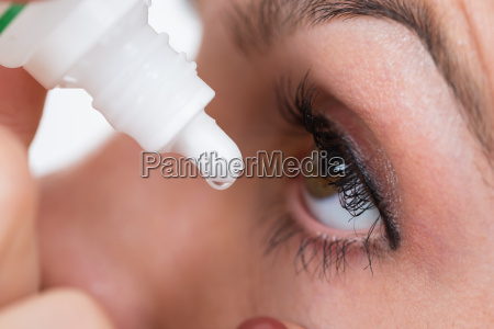 close up person drops in augen