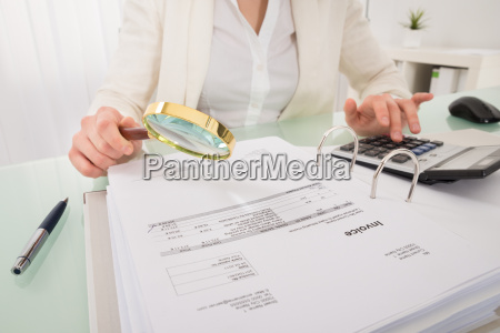 close up of businesswoman checking bill