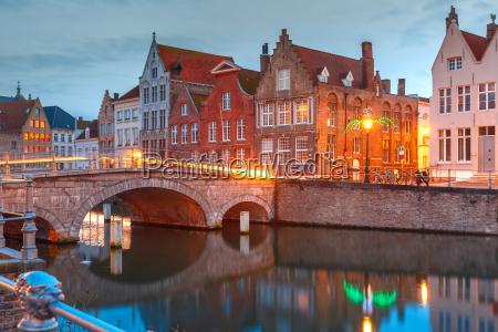 night bruges canal and bridge belgium