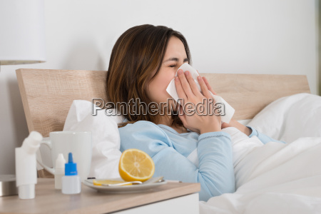 woman infected with cold lying on