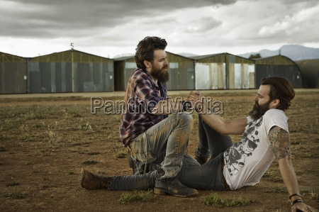 two men with full beards reconciling
