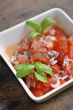 tomato salad with onions and garnished