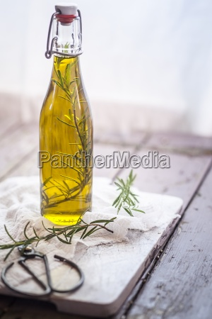 rosemary oil rosemary twig in olive