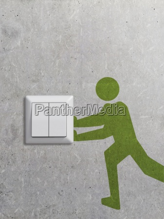 light switch and pictogram on concrete
