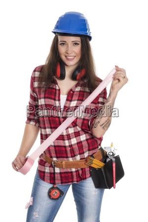 weiblicher handwerker mit klebeband