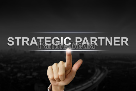 business hand pushing strategic partner button