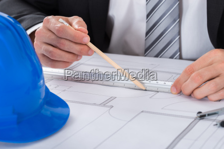 male architect hand using pencil and