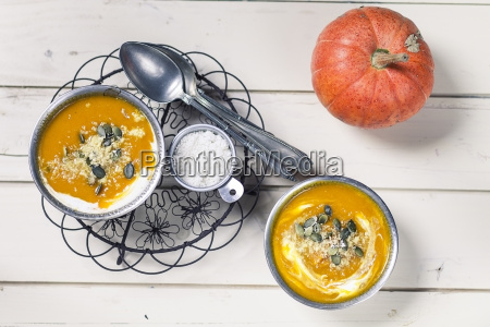 two bowls of exotic pumpkin soup