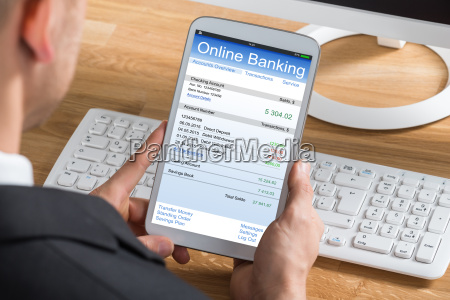 businessperson online banking using digital tablet