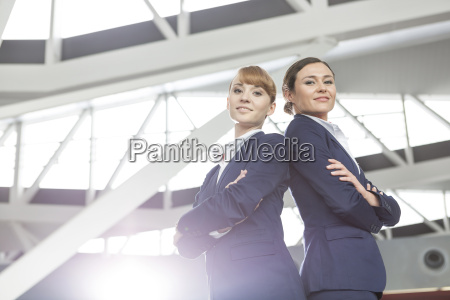 two flight attendants at the airport