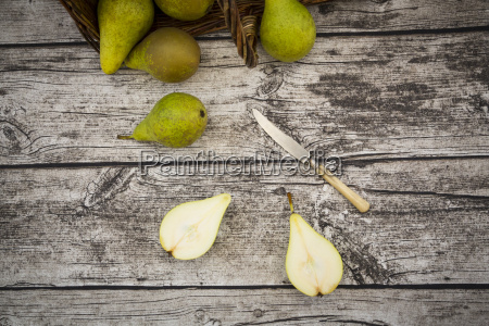 whole and sliced organic pears and
