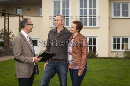 estate agent with potential buyers in