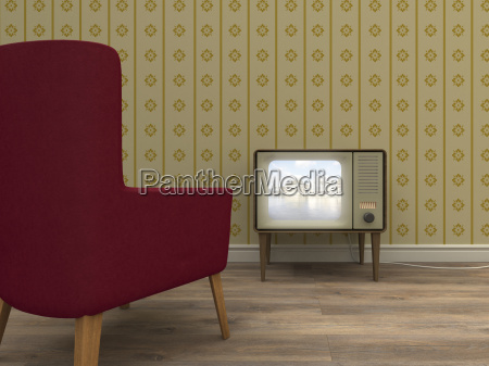 old television and red armchair in