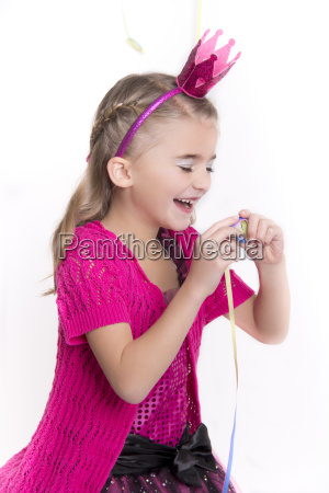 laughing little girl masquerade as a
