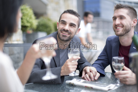 gay couple sharing meal with a