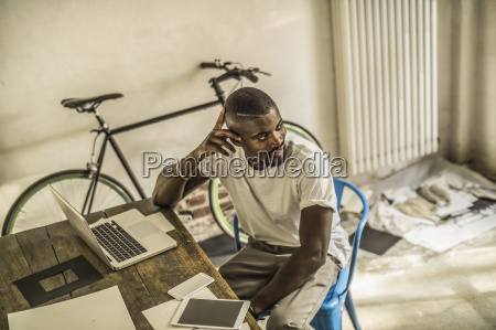 portrait of young manwith laptop in