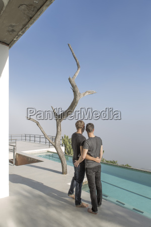 gay couple standing on a terrace