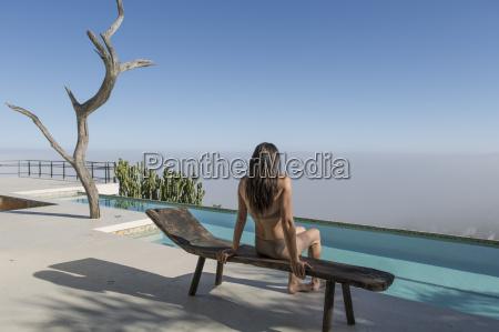 woman sitting on a lounge next