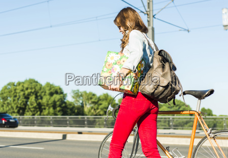 young woman with bicycle on the