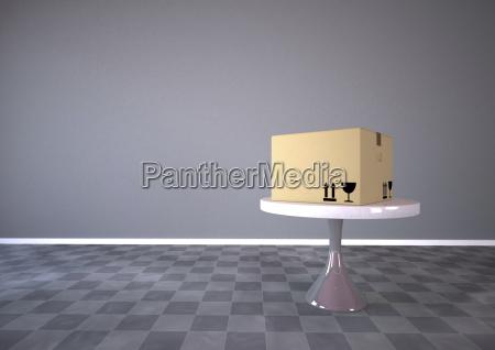 karton auf einem runden tisch3d rendering
