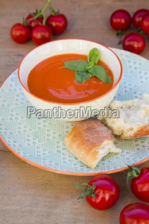 bowl of tomato cream soup garnished