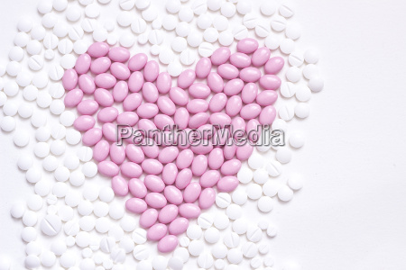 pink heart shaped of pills in