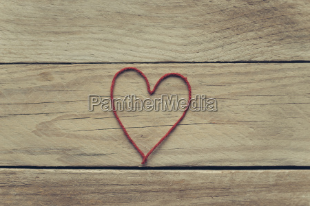 heart shaped of red thread on