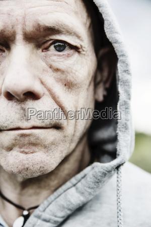 portrait of pale man wearing hooded