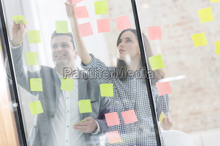 colleagues in office behind glass pane