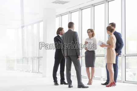 businesspeople talking in office at the