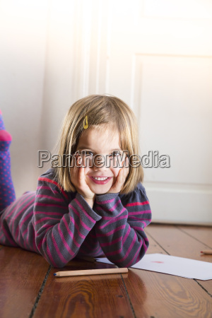 portrait of little girl lying on