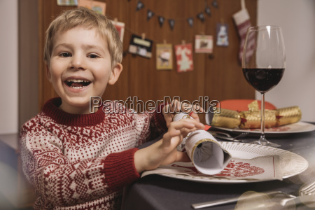 happy boy at christmas dinner table
