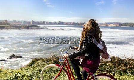 spain gijon playful young woman riding