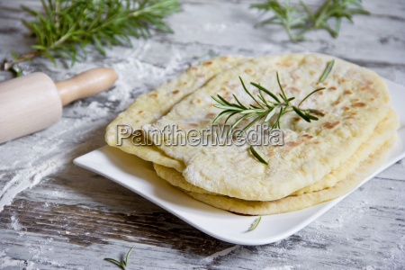 stack of naan breads with rosemary