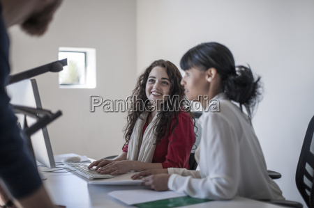 young creative professionals working at computer