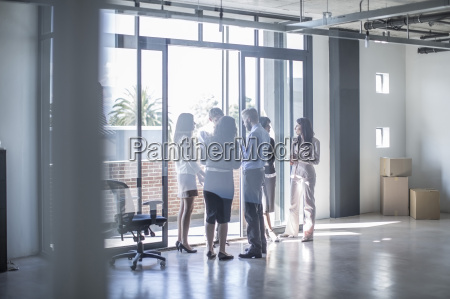 businesspeople talking at the window in