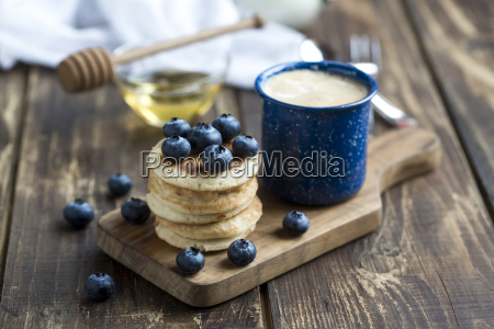 stack of mini pancakes blueberries and