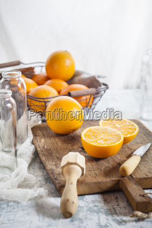 whole and sliced orange juice squeezer
