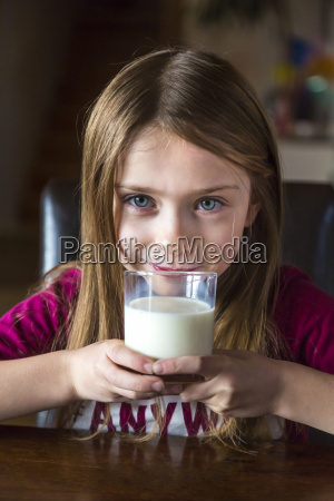 portrait of girl drinking glass of