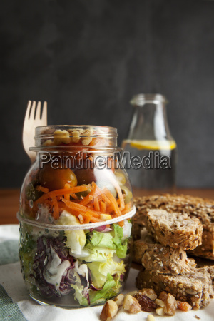 glass with salad to go